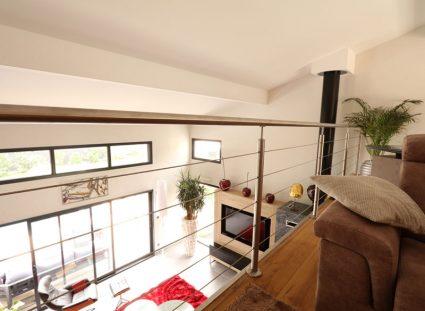 baie vitrée surmontée d'un bandeau panoramique