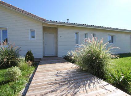 maison bois avec bardage beige